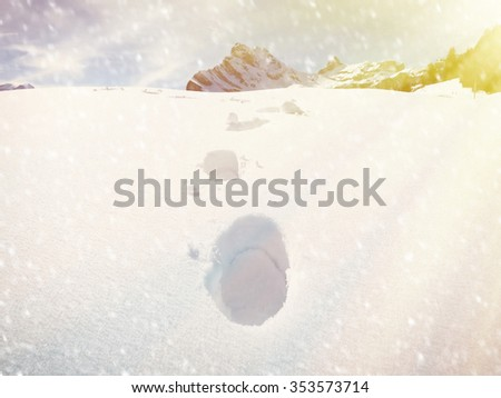 Footprint in the deep snow - stock photo