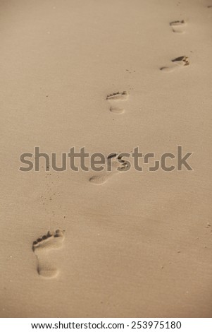 Footprint on beach sand - stock photo