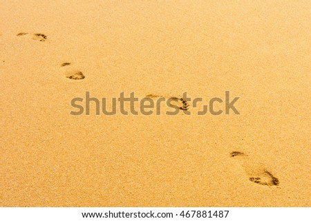 Footprint on sand on the beach.