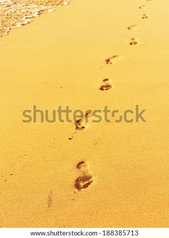 Footprint on sand with waves