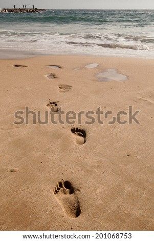 Footprints in the sand, at the beach, Cova do Vapor, Portugal