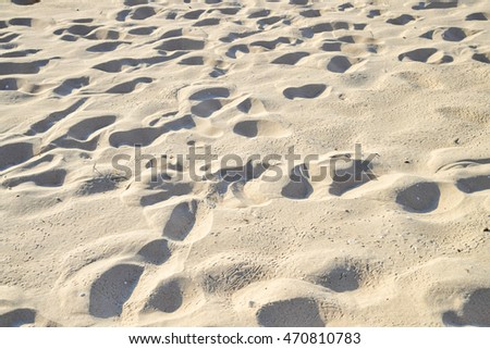 Footprints in the sand background.