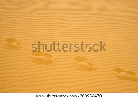 footprints in the sand in the desert, a free man - stock photo