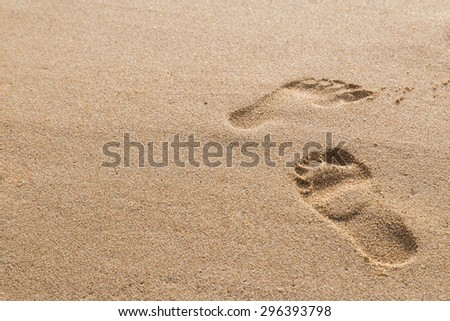 footprints in the sand on the beach  background