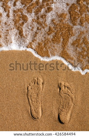 footprints in the sand. sea. Photo footprints on the sand at the beach