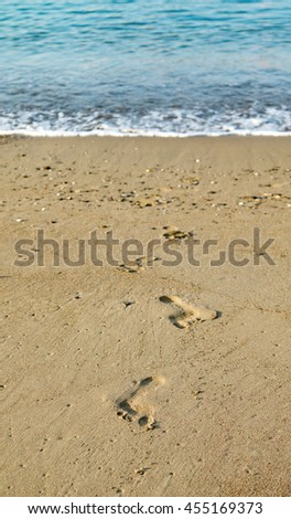 footprints in the sand, seascape