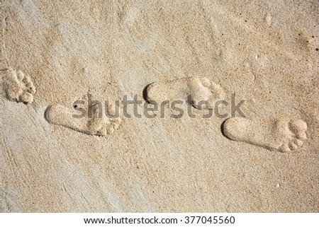 Footprints in the sand. Travel to Sea beach, foot steps - stock photo