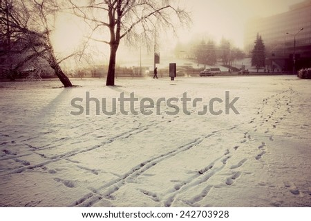Footprints in the snow, Snow background, Winter background, Winter snow or Winter field - stock photo