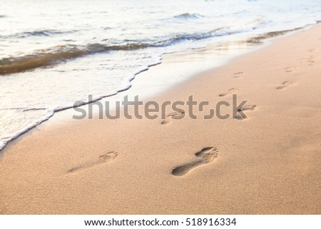 footprints of couple on the sand of beach, concept of past