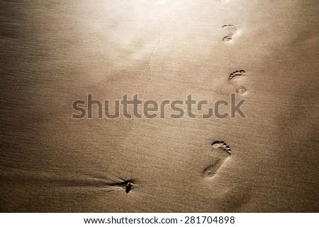 Footprints on sand, selective focus - stock photo