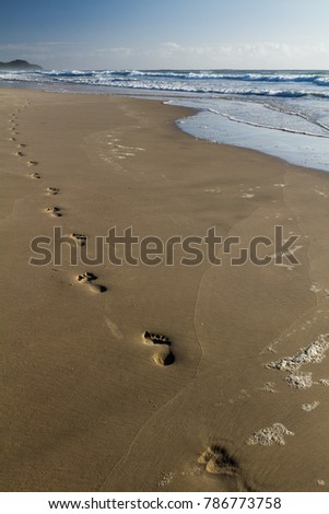 Footprints on Tallow Beach on northern New South Wales, Australia
