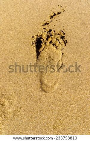 Footprints on the beach of the Black Sea - stock photo