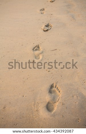 Footprints on the sand beach.