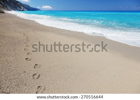 Footprints on the sandy beach, Lefkada island, Greece - stock photo