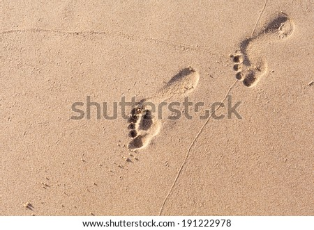 Footprints on the tropical beach.