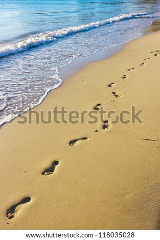 Footprints on the wet sand, Hawaii - stock photo