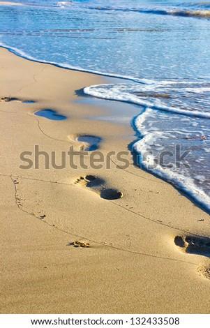 Footprints on the wet sand, Hawaii - stock photo
