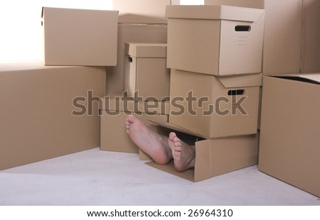 Foots of a men looking out of a cardboard box