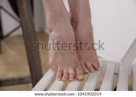 foots of lady. woman' legs. picture of pedicure. white skin of lady