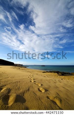 footstep in lanzarote   spain  rock stone sky cloud beach  water  musk pond  coastline and summer  - stock photo