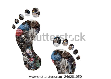Footsteps and municipal waste as carbon footprint concept - stock photo