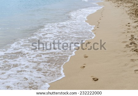 Footsteps on the sand - stock photo