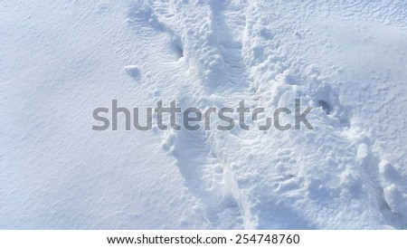 Footsteps on the snow background - stock photo