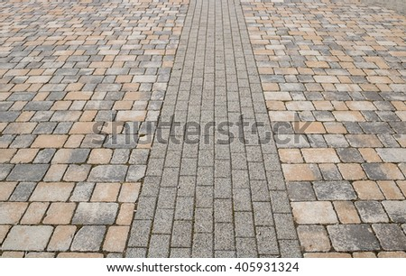 Footway street pavement background with colorful combined paving - stock photo