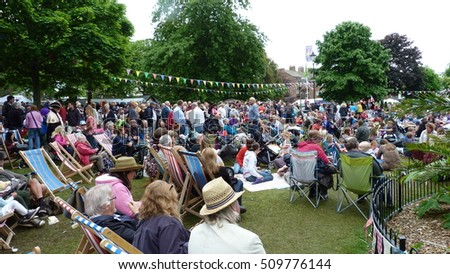 For Editorial Use. May 2014.  Exmouth England. The town park is full of people  enjoying a Music Festival in Summertime. This as a popular event held each year in this coastal town