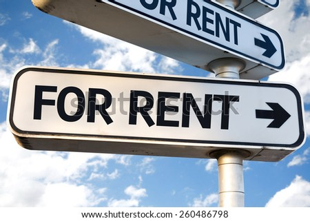 For Rent direction sign on sky background - stock photo