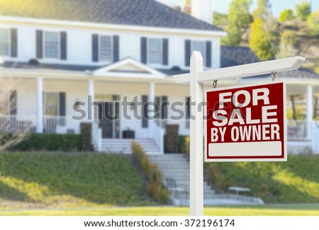 For Sale By Owner Real Estate Sign and Beautiful House. - stock photo