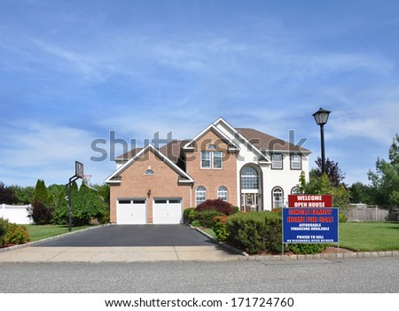 For Sale Real Estate Open House sign Suburban McMansion style brick home Landscaped sunny residential neighborhood USA blue sky clouds - stock photo