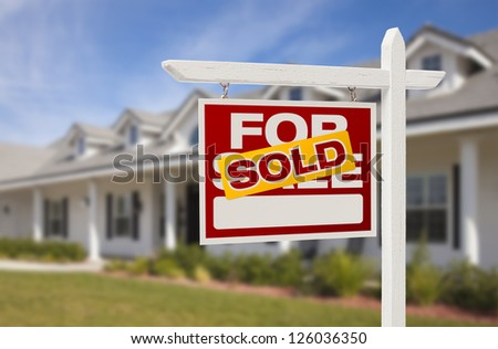 For Sale Sold Real Estate Sign and New House. - stock photo