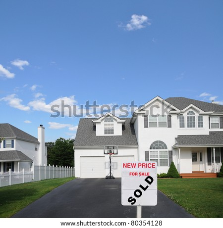For Sale Sold Sign at end of Suburban Residential Home Driveway - stock photo