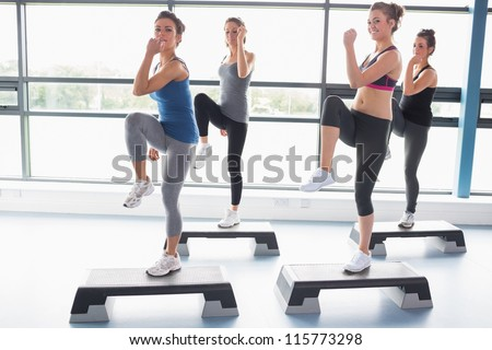 For women raising their leg swhile doing aerobics in gym