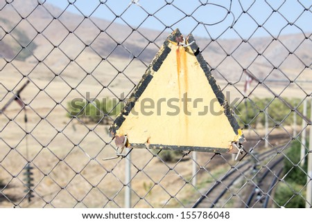 Forbidden sign on the chain-link fence