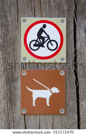 Forbidden to cycle an dog on a leash sign - stock photo