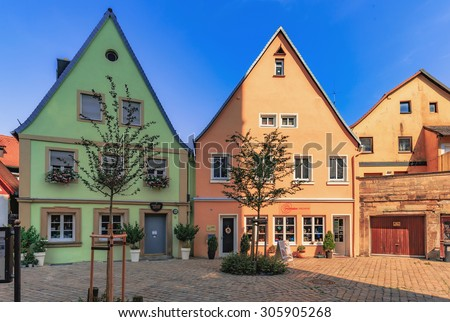 FORCHHEIM, GERMANY - AUGUST 12 2015: Historical Buildings on a hot summer day in the inner city of the Franconian town of Forchheim. Clear blue sky and summer heat