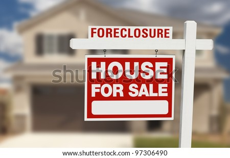 Foreclosure House For Sale Sign in Front of Beautiful Home. - stock photo
