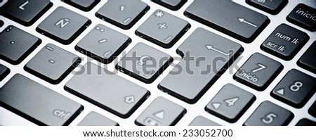 Forefront of a gray laptop keyboard.