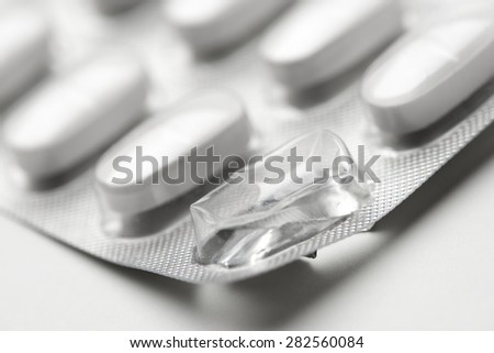 Forefront of a white medicine pills in blister pack. - stock photo
