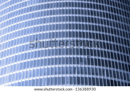 forefront of the glass facade of a skyscraper - stock photo