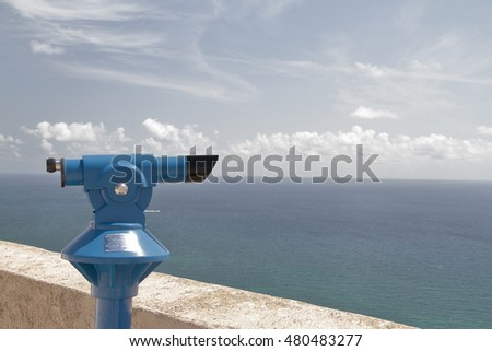foreground of a blue panoramic telescope overlooking the Mediterranean sea