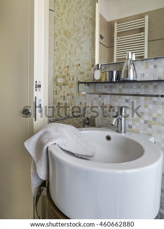foreground of a modern round washbasin in the modern bathroom