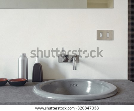 foreground of Vanity basin in the modern bathroom - stock photo