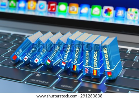 Foreign languages learn and translate education concept, books with flags of world countries on computer laptop keyboard - stock photo