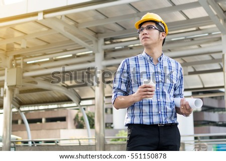 Foreman construction worker holding blueprint