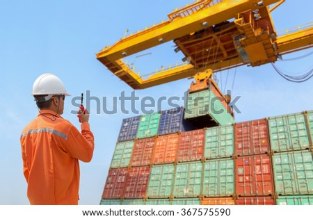 foreman control loading Containers box from Cargo freight ship - stock photo