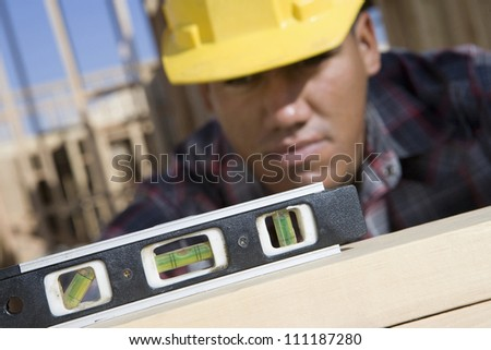 Foreman examining framework at construction site - stock photo