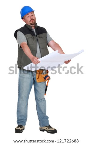 Foreman going over plans - stock photo